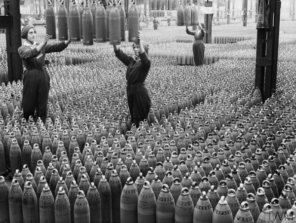MUNITIONS PRODUCTION ON THE HOME FRONT, 1914-1918 (Q 30040) Female munitions workers guide 6-inch howitzer shells being lowered to the floor at the National Shell Filling Factory in Chilwell, Nottinghamshire around 21 August, 1917. Copyright: © IWM. Original Source: http://www.iwm.org.uk/collections/item/object/205196487