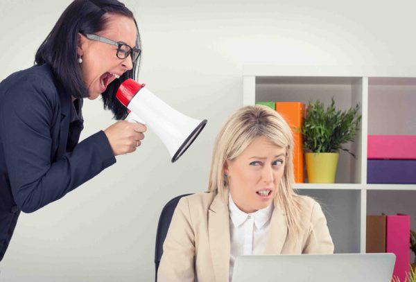 Boss yelling at employee on megaphone